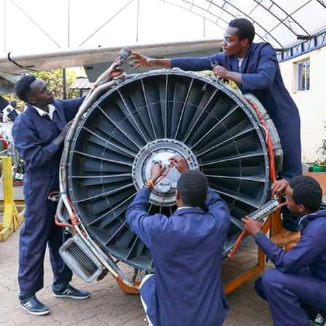 students operating on an airframe engine
